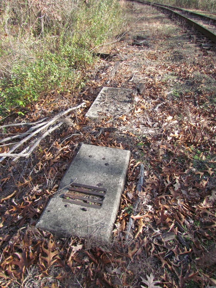 Concrete footings for a mechanical pipeline run down the CNJ connection to the location of the former wye switch where footings for old signals can also be found.