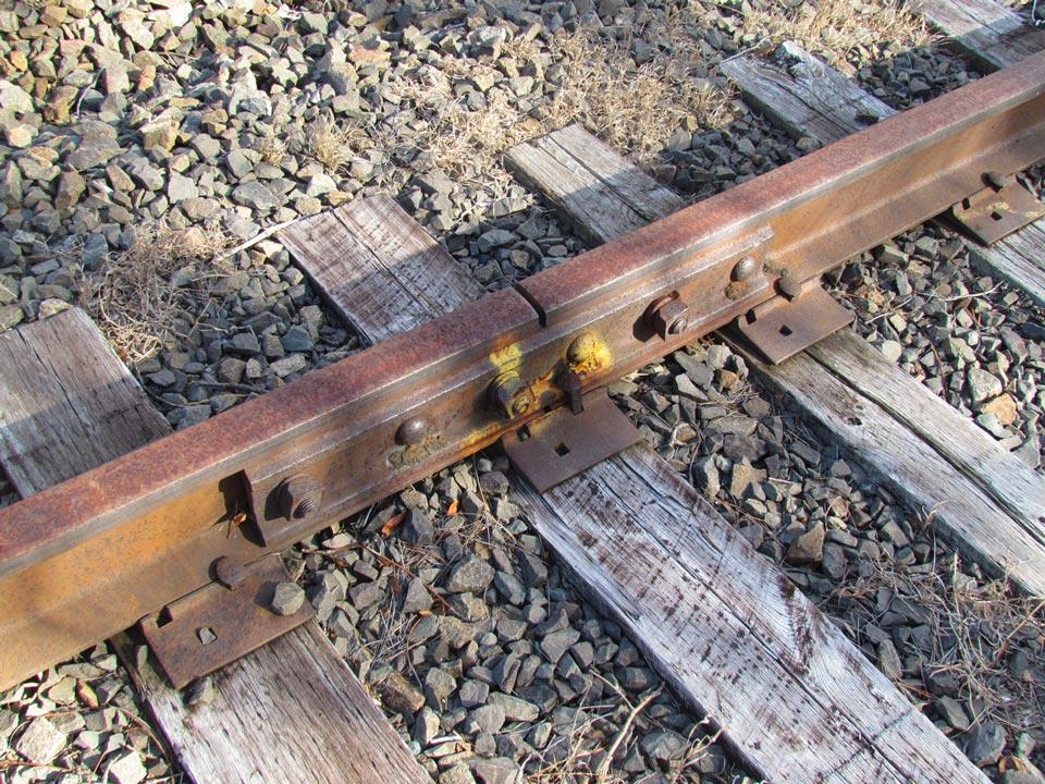 Rusted 6-bolt main line rail on the storage siding.