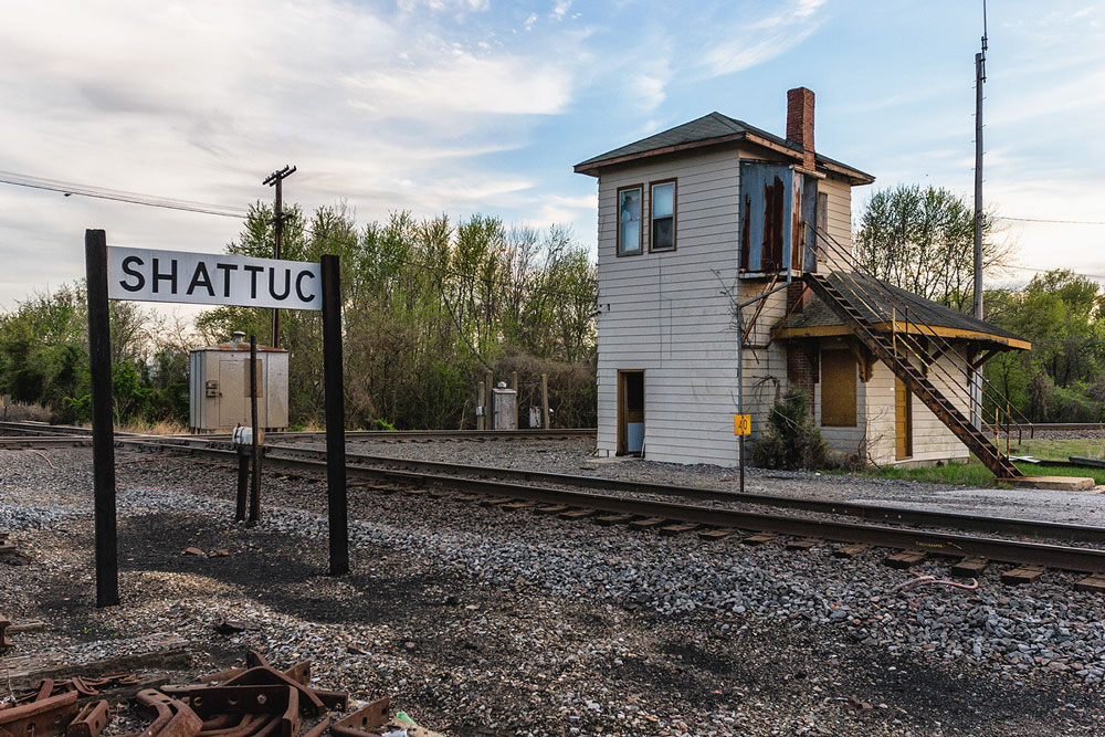 The sign along the BNSF's Beardstown Subdivision for the town of Shattuc.