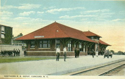 The Concord passenger station depicted in its full glory in this picture postcard circa 1920. The Cabarrus Cotton Mill is visible behind the structure. Image courtesy Concord Public Library