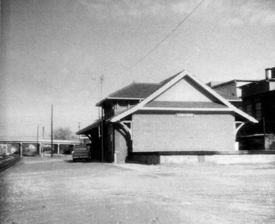 A view of the less seen south end of the passenger station as it appeared during the 1960s. The bridge in the distance is Cabarrus Avenue and the freight depot---now gone-- was on the immediate opposite side. Image Concord Public Library/Independent Tribune