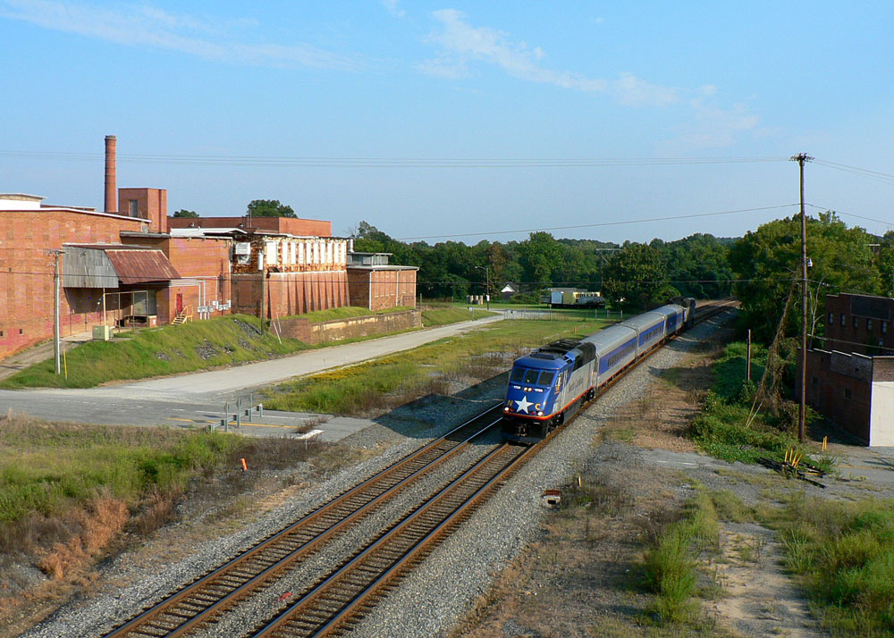 After: Four decades later, a similar view of the station area. Amtrak #76 passes in ironic vigil where whence passenger trains stopped. Image Dan Robie 2016