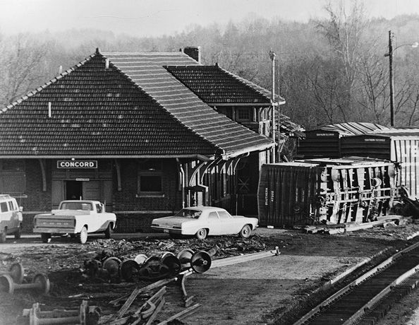 In March 1974, a northbound Southern Railway manifest derailed in proximity to the passenger station. As evidenced in this image, cars were scattered and the structure received damage to its front. Image William Teal/Independent Tribune.