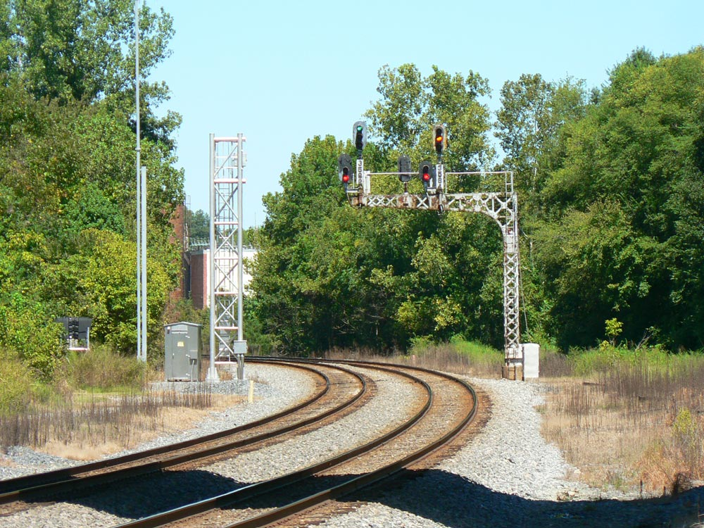 Many an engineer looked at this cantilever signal as northbound trains departed Concord. It, too, will pass into history as evidenced by its replacement under construction. Dan Robie 2016
